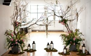wedding decorations hanging from branches of trees
