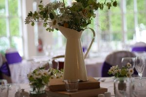 distressed cream jug wedding centre piece