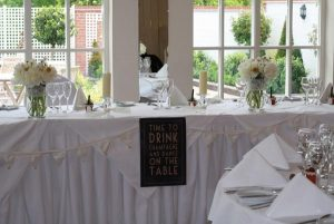 time to drink champagne and dance on the table wedding sign