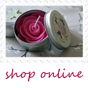 pink flower candle in vintage tin