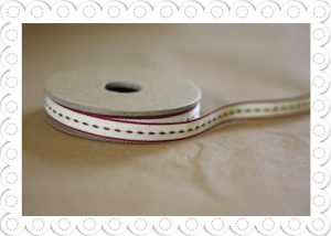 ribbon with red stitching