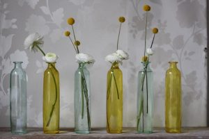 yellow and green glass bottles