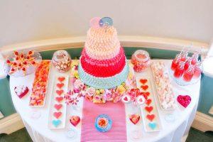 pink wedding dessert table with mini milk bottles