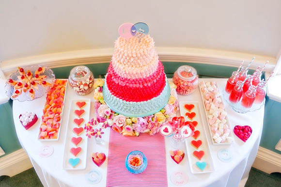 pink wedding dessert table with mini milk bottles