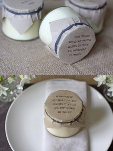 candles in jam jars with brown paper lids wedding favours