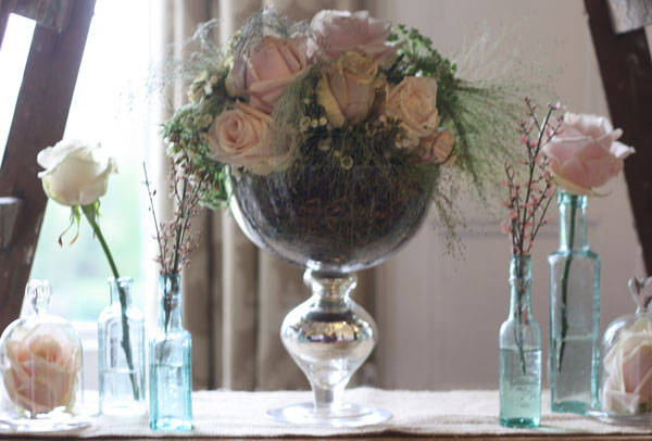 footed vases low wedding flowers muted roses