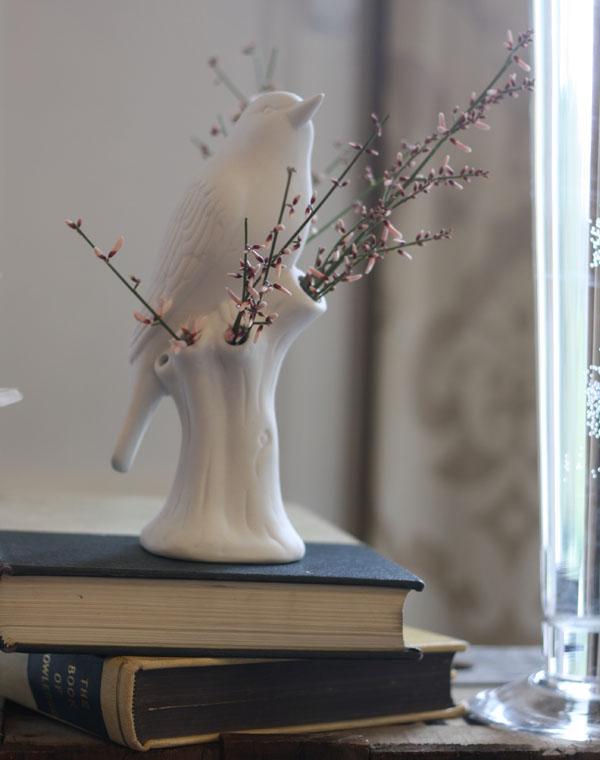 white bird vase flowes
