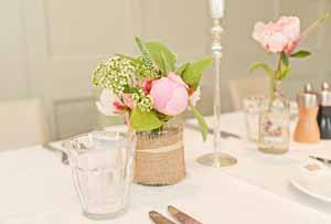 hessian and ribbon jam jar wedding decorations