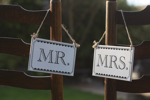 mr and mrs black and white wedding signs chair backs
