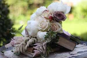 vintage rose bouquet on books