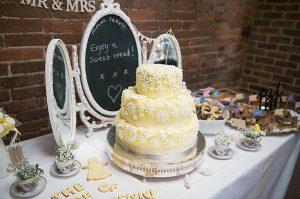 wedding cake table dessert table yellow
