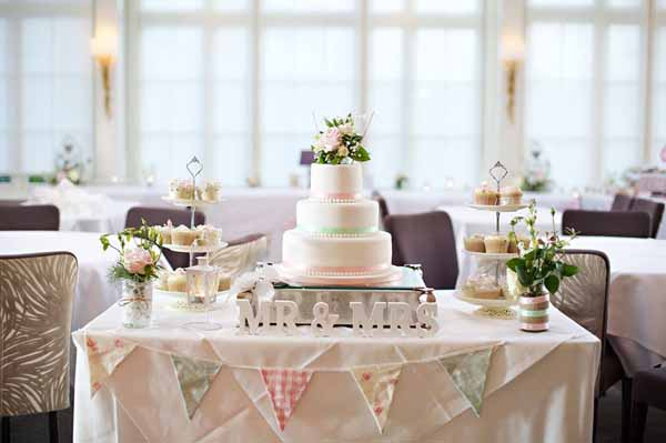 country garden wedding cake with mini bunting cake topper