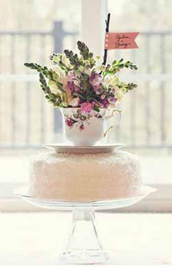 flowers in a tea cup wedding cake topper
