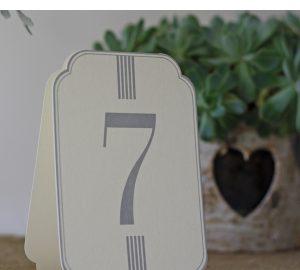 set of cream grey card wedding table numbers