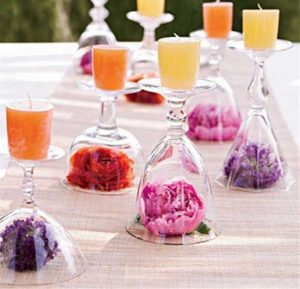 diy wedding centrepiece wine glasses candles flower heads