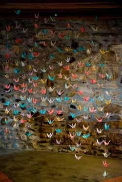 bright coloured paper cranes wedding backdrop