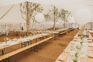 long wedding tables marquee wedding with trees