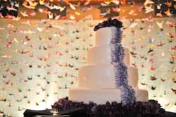 origami paper cranes backdrop to wedding cake