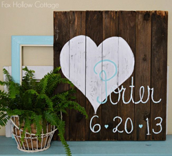 paint your wedding date on rustic wooden panels and display at your wedding
