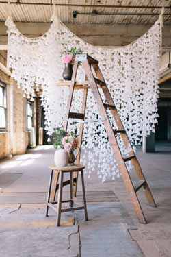 white paper origami wedding backdrop
