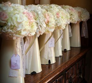 display bouquets in cream jugs for bridesmaids