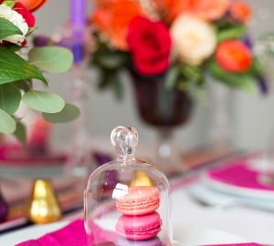 mini glass bell jar with macaroons fruit in bloved wedding styling