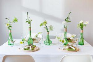 green glass bottles wedding centrepies organic shape rustic wedding decorations