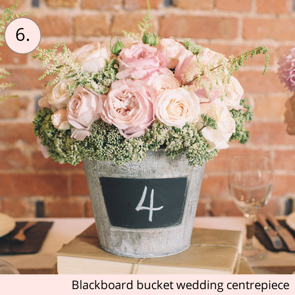 chalkboard bucket rustic wedding centrepiece ideas - 15 wedding centrepieces for under 15 pounds (budget friendly centrepieces)