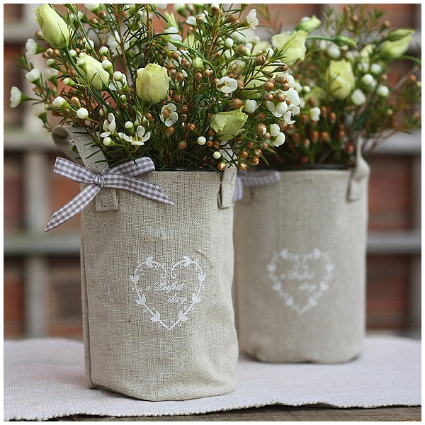 hessian wedding ideas jam jars wrapped in hessian as vases