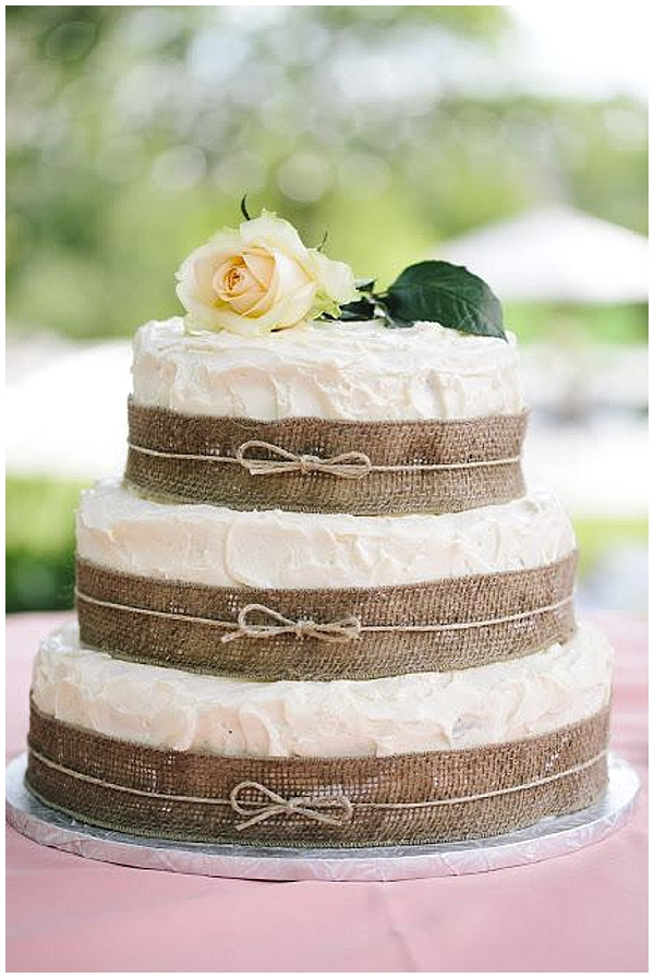 hessian wedding ideas wedding cake with burlap ribbon around layers