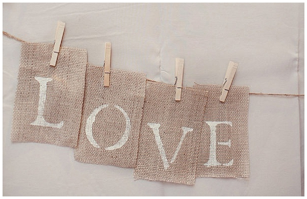 paint words on to hessian and peg up for rustic wedding signs hessian wedding ideas