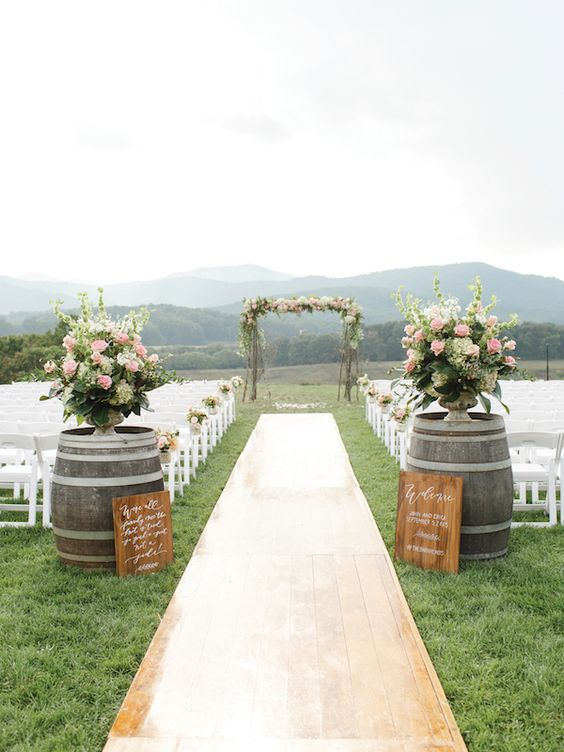 outdoor wedding ceremony wine barrels