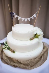 rustic wedding cake with mr and mrs cake bunting topper