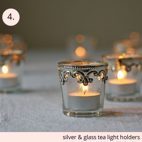 silver and glass tea light holders