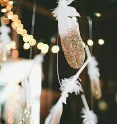feather dipped in gold glitter