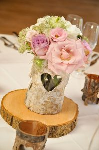 rustic centrepieces tree slices packington moor wedding flowers passion for flowers