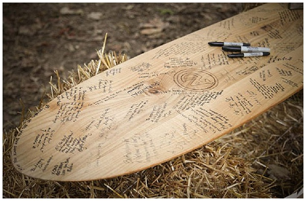sign surfboard hobbey you both love alternative wedding guest book ideas