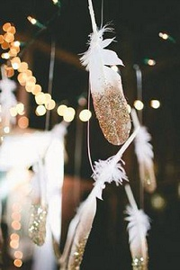 gold dipped feathers hanging