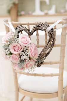 blush pink wedding ideas heart chair backs for the bride and grooms chairs