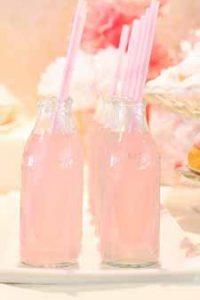 blush pink wedding ideas pink lemonade in milk bottles with pink straws