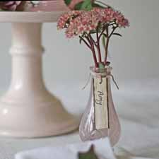 blush pink wedding ideas place a pink bud vase with the name card hanging around the neck on every place setting