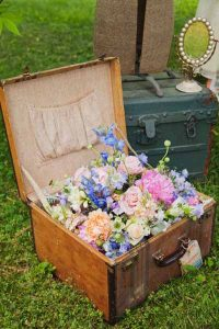 so pretty add flowers to a vintage suitcase