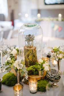 woodland wedding centrepiece ideas bell jars wooden tree slices and silver tea light holders