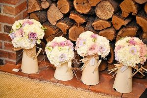 Cream jugs with bridesmaids bouquets