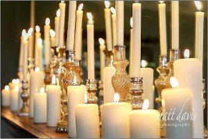 Mercury silver candle sticks on fireplace