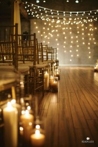 lanterns with candles as aisle decorations for wedding ceremonies