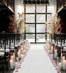 non floral aisle decorations candles in glass lanterns