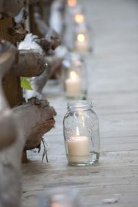 non floral aisle decorations candles in jam jars