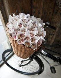paper confetti cones in a bicycle basket