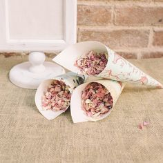 paper confetti cones made from paper available to buy online from www.theweddingofmydreams.co.uk
